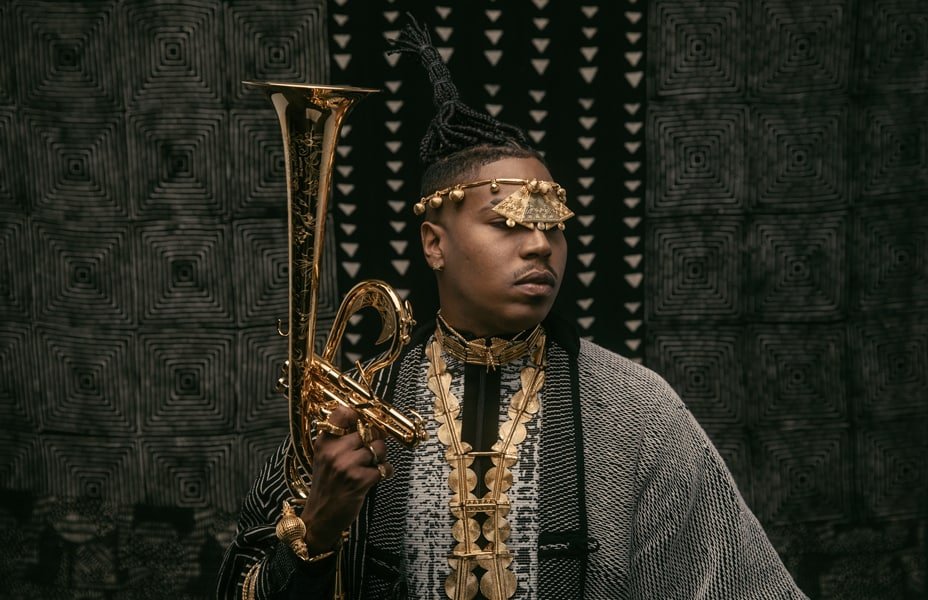 Christian Scott posed with his trumpet
