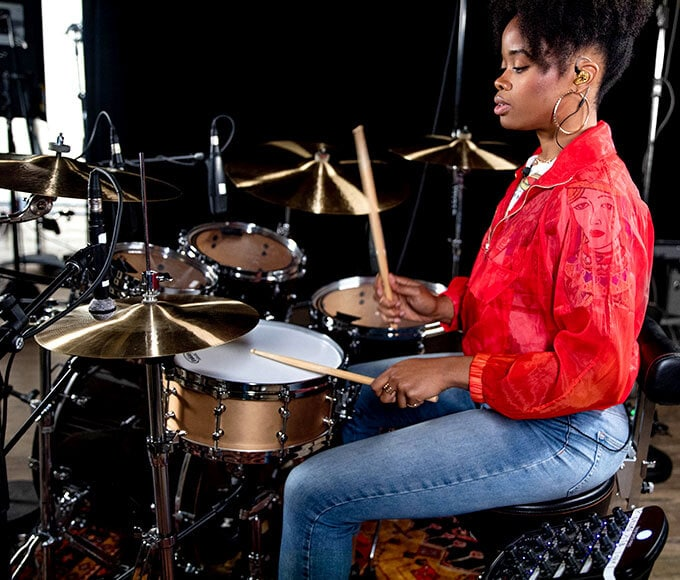 The Pocket Queen playing drums.