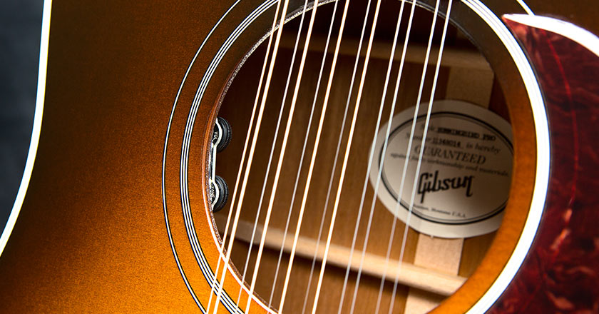 The neck of the Hummingbird Pro 12-String with Grover Mini Rotomatic tuners