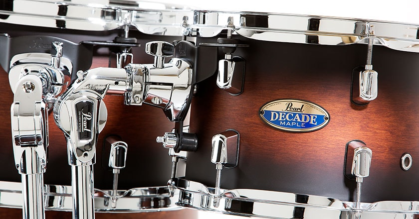 Rack tom featuring Pearl mini lugs, triple-flange hoops, Uni-Lock gearless tom arm and bass drum suspension mount