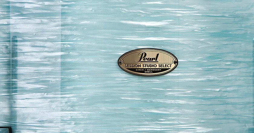 Pearl Session Studio Select Badge on Ice Blue Oyster drum shell
