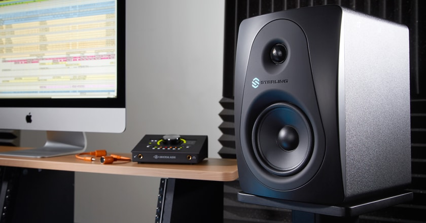 Sterling MX5 Studio Monitor Front View With Computer In Background