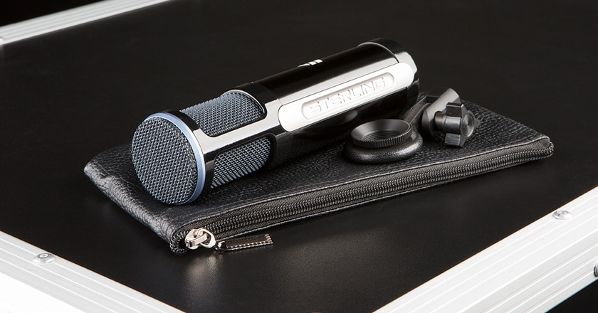 The Sterling ST151 Microphone Laying on its Side with its Leather Carrying Pouch and Mic Clip