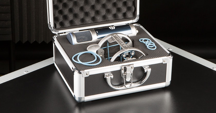 A Close-up Image of the Sterling ST159 Microphone with its Mic Clip on Top of the Included Carry Case