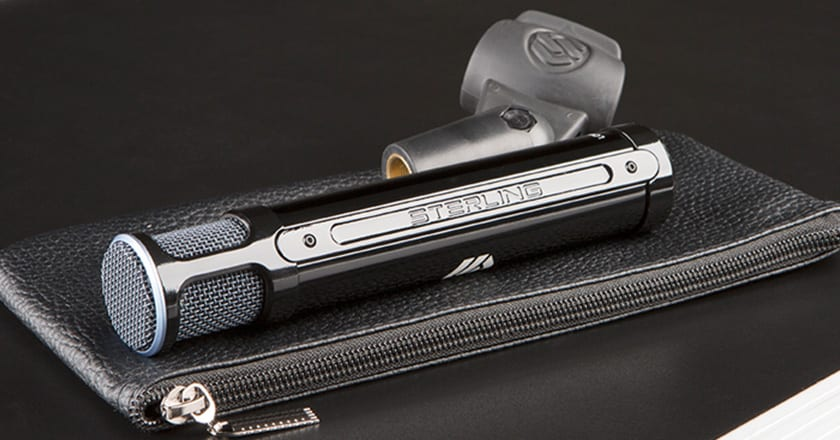 A Close-up Image of the Sterling ST131 Microphone with its Mic Clip on Top of the Included Carry Case