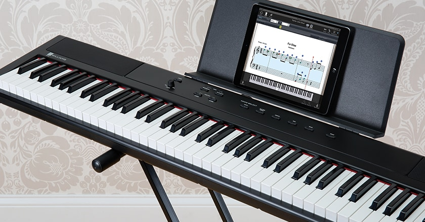 Williams Legato III Keyboard on Keyboard Stand with iPad